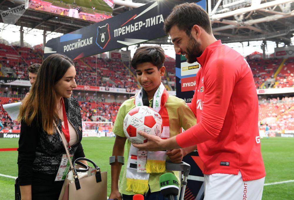 Desire for Life: Iraqi boy Qassem Qadim Attends Football Match in Moscow