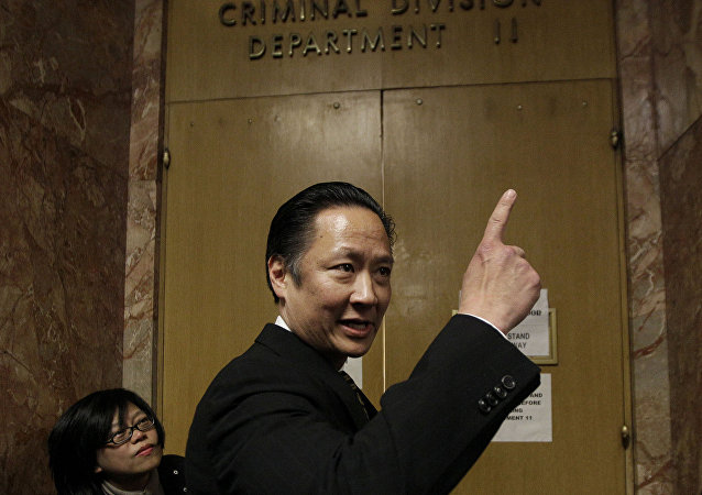 In this March 28, 2012 file photo, San Francisco Public Defender Jeff Adachi enters a courtroom at the Hall of Justice in San Francisco. A freelance journalist is vowing to protect his source after San Francisco police raided his home and office as part of a criminal investigation. Bryan Carmody tells the Los Angeles Times that officers handcuffed him Friday, May 10, 2019, as they confiscated items including his cell phone, computer and cameras. Authorities say the raid came during an ongoing probe into who leaked a confidential police report about the Feb. 22 death of Adachi.