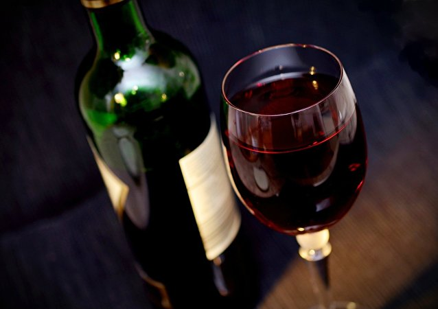 Glass of red wine, bottle