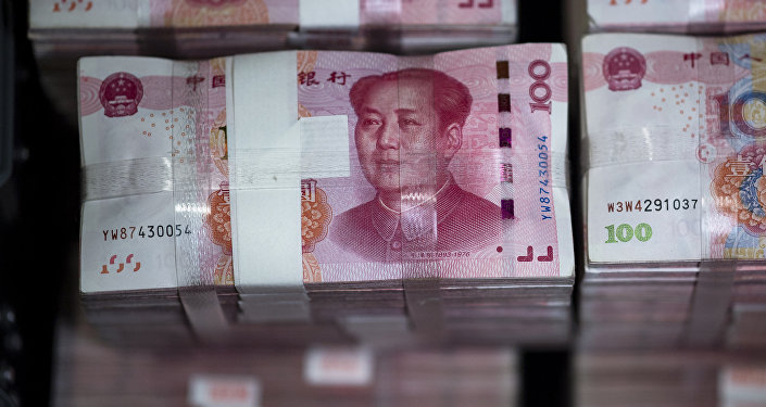 Bundles of 100 yuan notes are pictured at a bank in Shanghai