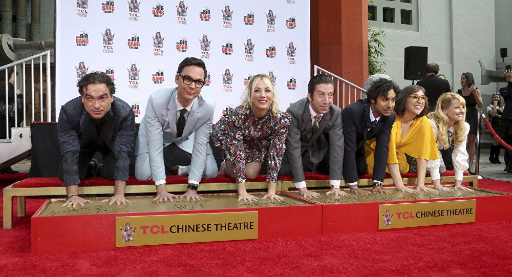 Johnny Galecki, from left, Jim Parsons, Kaley Cuoco, Simon Helberg, Kunal Nayyar, Mayim Bialik and Melissa Rauch, members of the cast of the TV series The Big Bang Theory, place their hands in cement during a hand and footprint ceremony at the TCL Chinese Theatre on Wednesday, May 1, 2019 at in Los Angeles