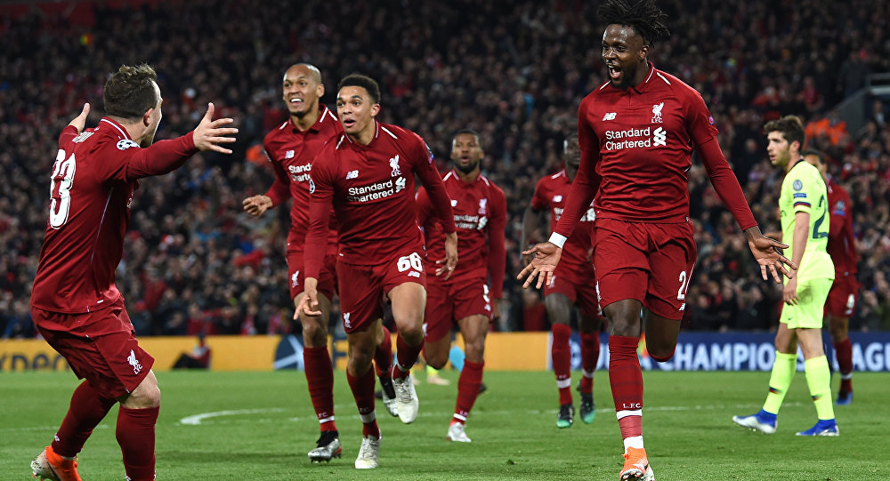 Divock Origi (far right) celebrates his winning goal against Barcelona with Liverpool team-mates