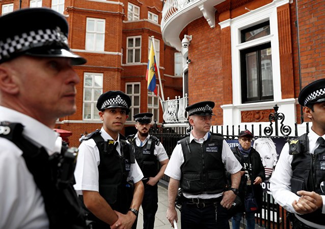 British police officers stand on duty outside the Embassy of Ecuador in London on May 20, 2019