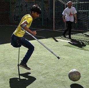 Iraqi Boy Qassem Qadim in Moscow