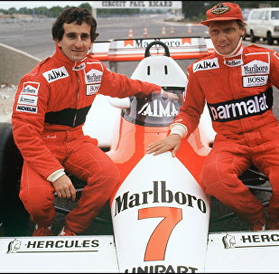 Niki Lauda (right) with his McLaren team Alain Prost in 1983