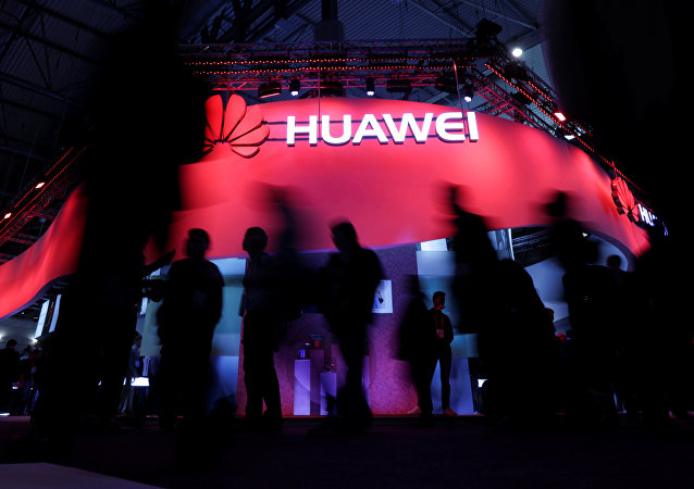 Visitors walk past Huawei's booth during Mobile World Congress in Barcelona, Spain, February 27, 2017