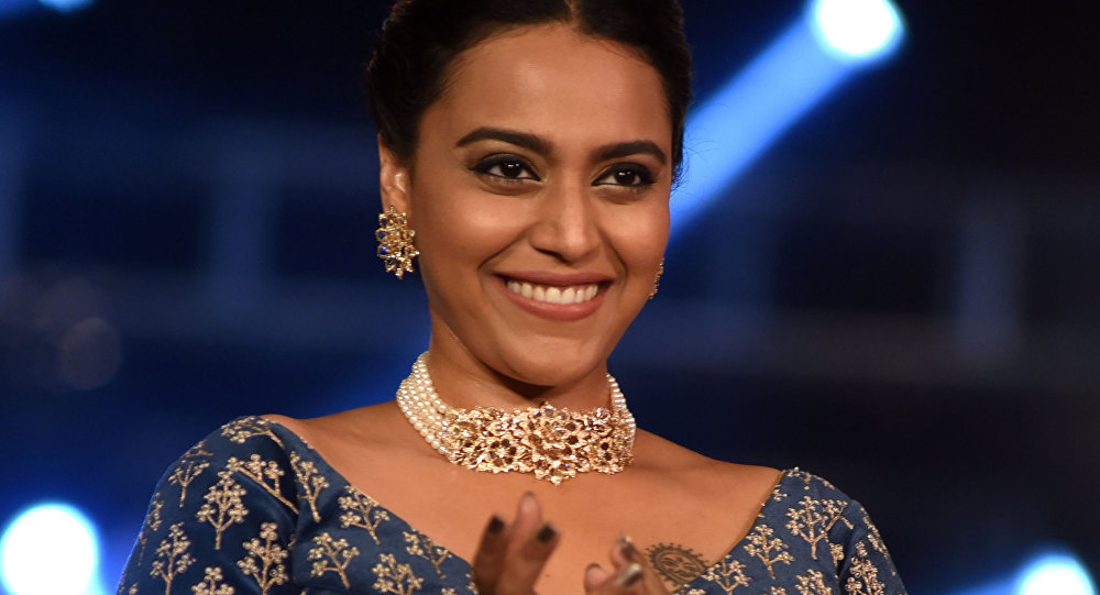 Indian Bollywood actress Swara Bhaskar showcases a creation by designer Richa Malkani during the second season of The Wedding Junction Show, in Mumbai on October 26, 2018