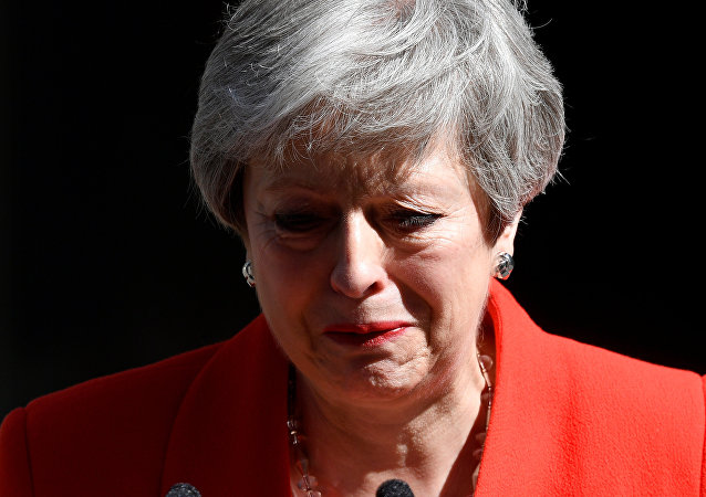 British Prime Minister Theresa May reacts as she delivers a statement in London, Britain, May 24, 2019
