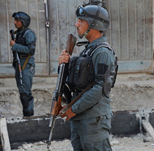 Afghan policemen stand guard at the site of a bomb attack near a mosque in Kabul (File)
