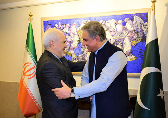 In this photo released by the Foreign Office, Pakistani Foreign Minister Shah Mehmood Qureshi, right, shakes hands with Iranian Foreign Minister Mohammad Javad Zarif at the Foreign Ministry in Islamabad, Pakistan, Friday, May 24, 2019