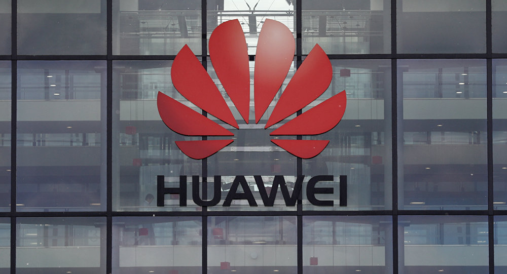 A picture shows the Huawei logo and signage at their main UK offices in Reading, west of London, on April 29, 2019. Experts called on 5G providers Friday, May 3, 2019 to heed supply chain security in light of concerns about technology providers such as China's Huawei, recently banned by the US government.