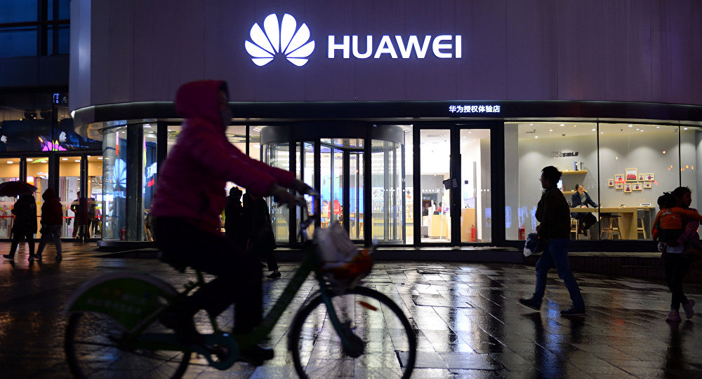 A woman cycles past a Huawei store in Shenyang, Liaoning province, China March 20, 2019. Picture taken March 20, 2019