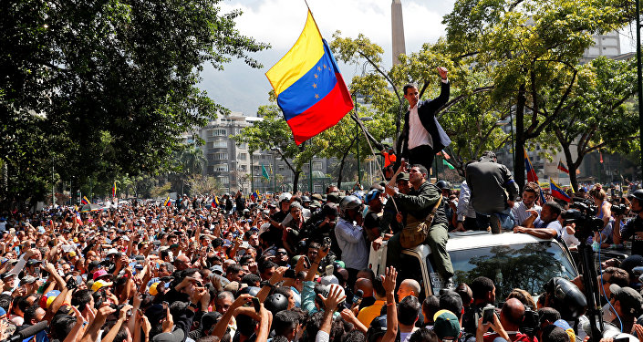 Venezuelan opposition leader Juan Guaido, who many nations have recognised as the country's rightful interim ruler, gestures after talking to supporters in Caracas, Venezuela April 30, 2019