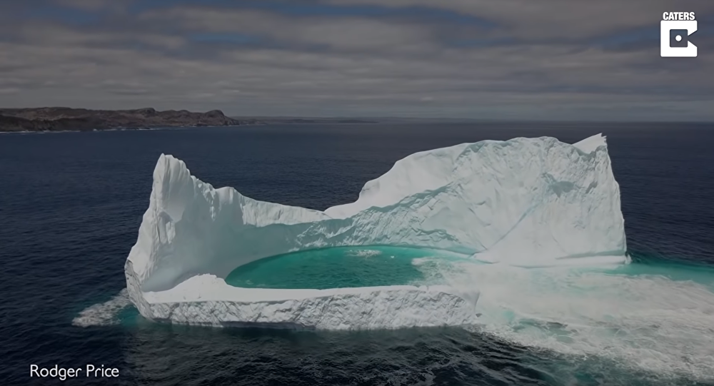 Drone Delivers Aerial View of Iceberg's Natural Pool