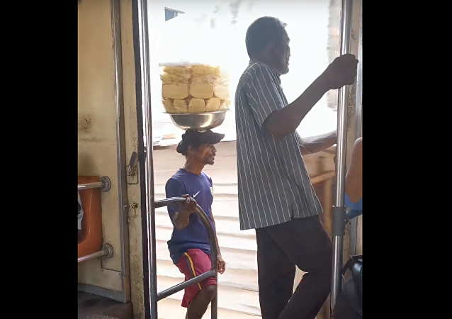 Sri Lanka Pineapple Salesman Shows Off Impeccable Balance