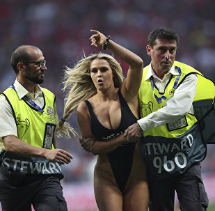 Kinsey Wolanski, a woman that invaded the pitch during the Champions League final soccer match between Tottenham Hotspur and Liverpool, is taken away by security at the Wanda Metropolitano Stadium in Madrid, 1 June 2019.