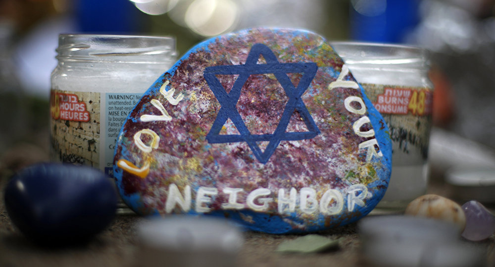 This Wednesday, Oct. 31, 2018, file photo, shows a painted rock found as part of a makeshift memorial outside the Tree of Life Synagogue in the Squirrel Hill neighborhood of Pittsburgh, in honor of the people killed during worship services several days earlier