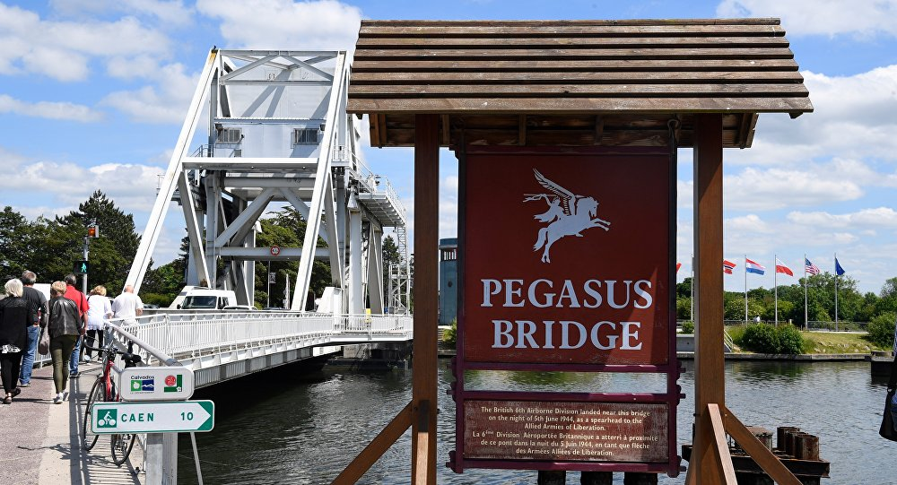 People cross Pegasus Bridge in Normandy - close to where the soldier died - on 31 May 2019
