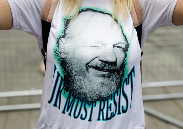 A supporter of WikiLeaks founder Julian Assange joins others in protest outside Westminster Magistrates Court in London on May 30, 2019 where there was a short hearing in Assange's extradition case