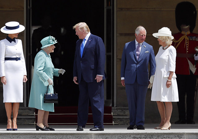 Britain's Queen Elizabeth II greets President Donald Trump, center, and first lady Melania Trump, left, with Britain's Prince Charles and Camilla, Duchess of Cornwall during a ceremonial welcome in the garden of Buckingham Palace in London, Monday, June 3, 2019 on the opening day of a three day state visit to Britain