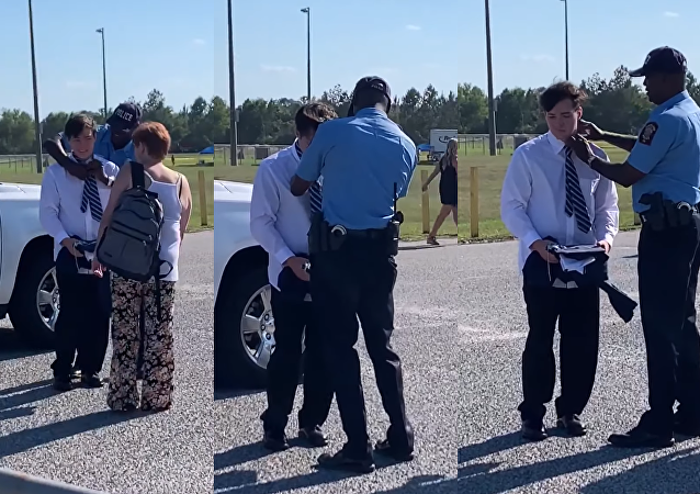 To Protect and Style? US Officer Comes to High School Grad's Rescue