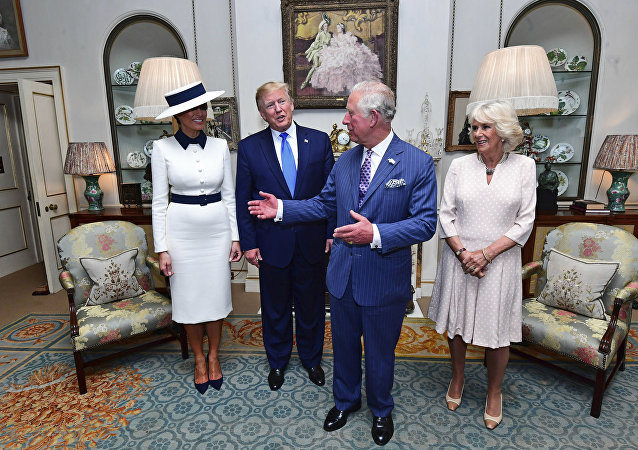 US President Donald Trump, centre left and his wife, first lady Melania, left, listen to Britain's Prince Charles and Camilla, the Duchess of Cornwall prior to afternoon tea at Clarence House, in London, Monday, June 3, 2019