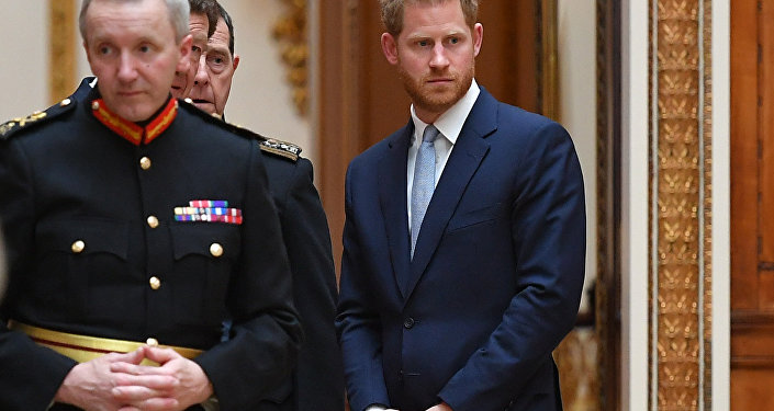 Britain's Prince Harry, Duke of Sussex looks on as US President Donald Trump views US items of the Royal Collection at Buckingham palace at Buckingham Palace in central London on June 3, 2019, on the first day of their three-day State Visit to the UK
