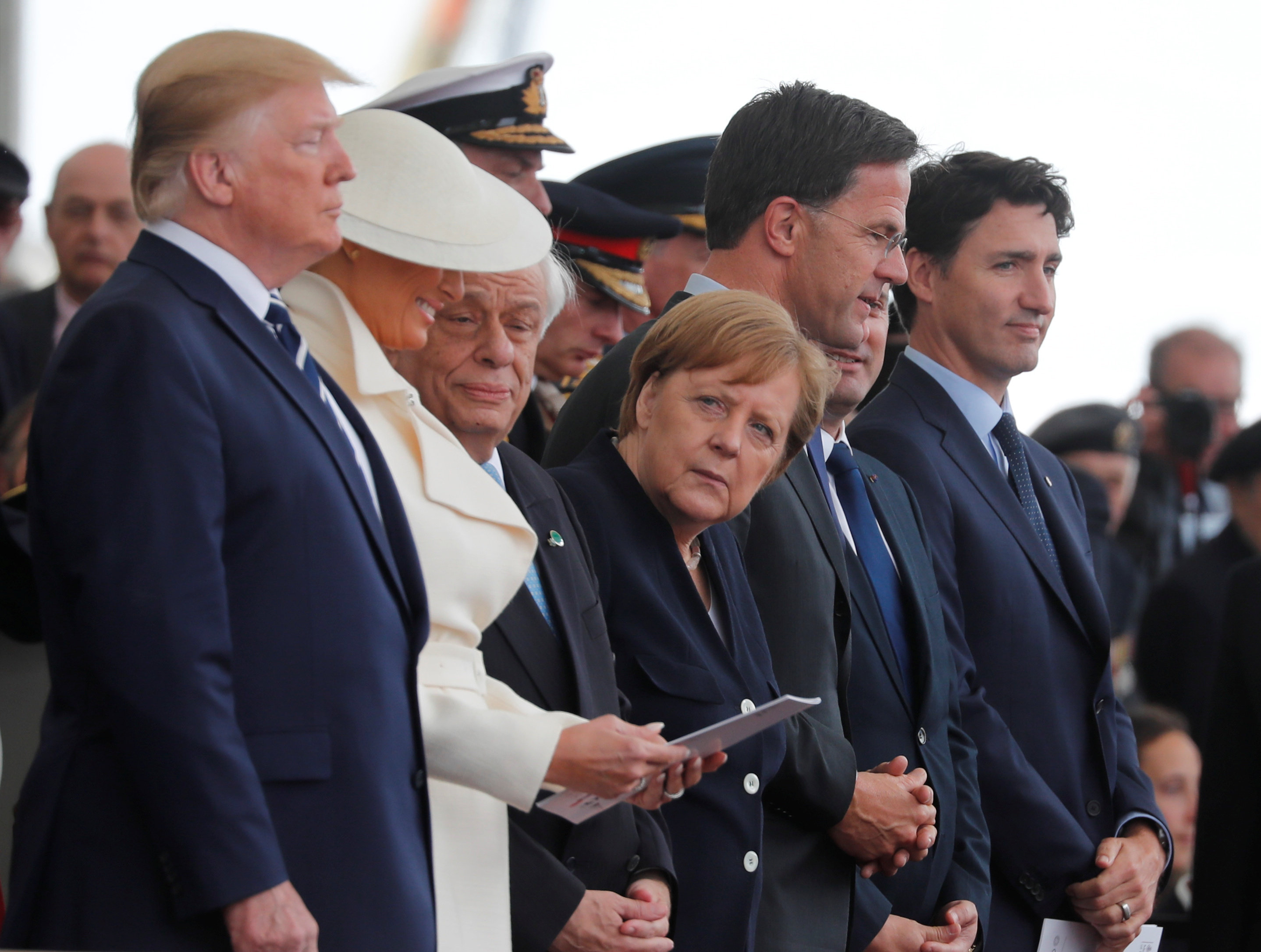 U.S. President Donald Trump, First Lady Melania, German Chancellor Angela Merkel, Dutch Prime Minister Mark Rutte and Canada's Prime Minister Justin Trudeau participate in an event to commemorate the 75th anniversary of D-Day, in Portsmouth, Britain, June 5, 2019
