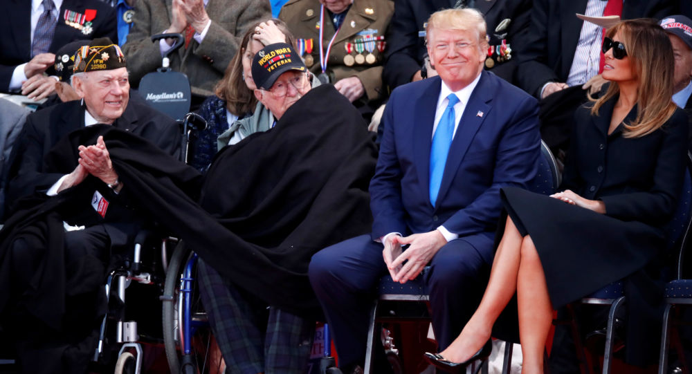 U.S President Donald Trump and First Lady Melania Trump sit next to WWII veterans during a ceremony to mark the 75th anniversary of the D-Day at the Normandy American Cemetery and Memorial in Colleville-sur-Mer, France, June 6, 2019
