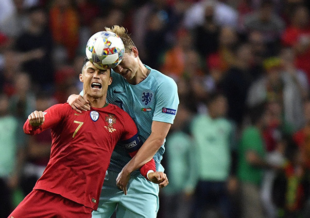 Portugal's Cristiano Ronaldo, left, jumps for the ball with Netherlands' Matthijs de Ligt during the UEFA Nations League final soccer match between Portugal and Netherlands at the Dragao stadium in Porto, Portugal, Sunday, June 9, 2019.