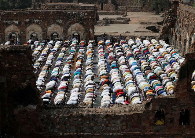 Muslims offer Eid al-Fitr prayers at the ruins of Feroz Shah Kotla mosque in New Delhi, India June 5, 2019