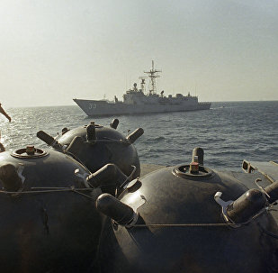 Mines aboard the ship Iran Ajr are inspected by a boarding party from the USS LaSalle in the Persian Gulf, Sept. 1987. The USS Jarett waits in the background. The two American boats were among those escorting U.S.-flagged Kuwaiti oil tankers through the Gulf in the face of the continuing Iran-Iraq War.