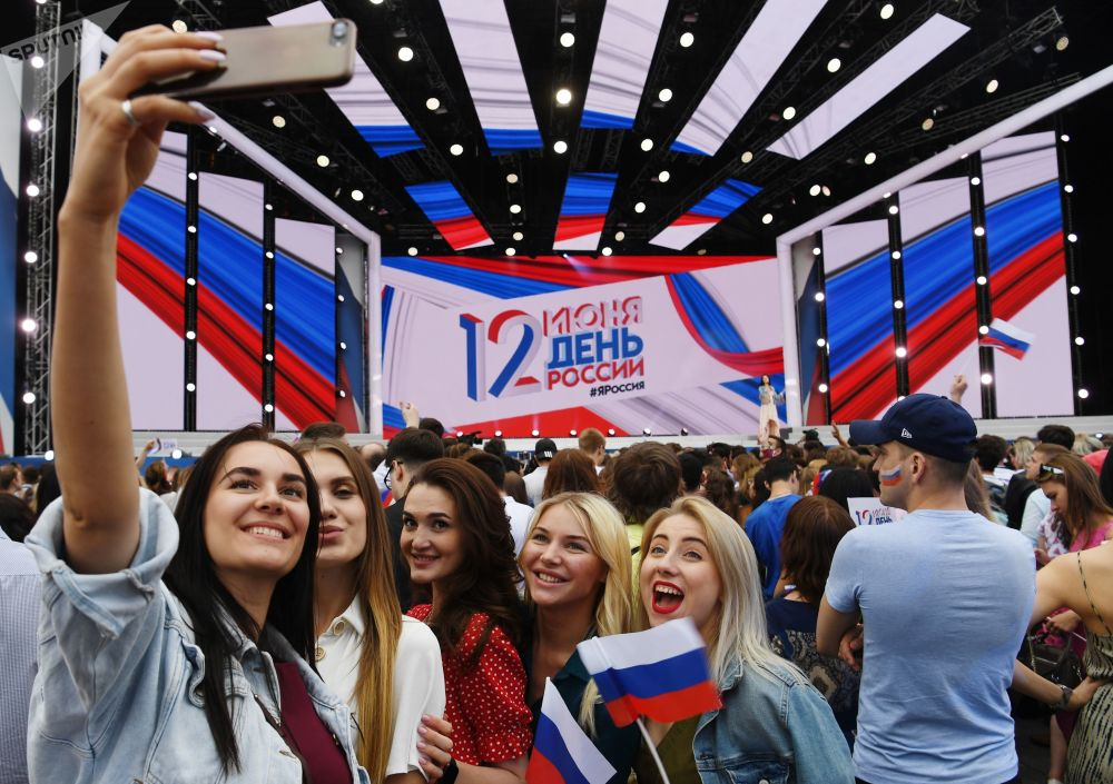 Women take a selfie during a festive concert marking the Day of Russia on Red Square in Moscow, Russia.
