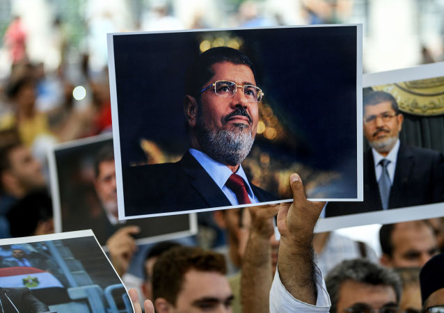 People hold picture of Egyptian President Mohamed Morsi during a symbolic funeral cerenomy on June 18, 2019 at Fatih mosque in Istanbul