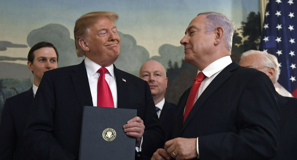 In this Monday, March 25, 2019 file photo, President Donald Trump smiles at Israeli Prime Minister Benjamin Netanyahu, right, after signing a proclamation in the Diplomatic Reception Room at the White House in Washington