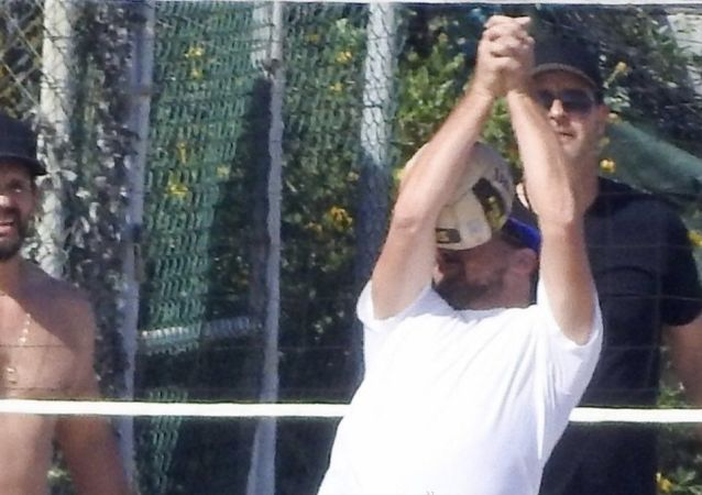 Leonardo DiCaprio gets whacked in the face by a volleyball