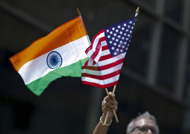 A man holds the flags of India and the U.S. (File)