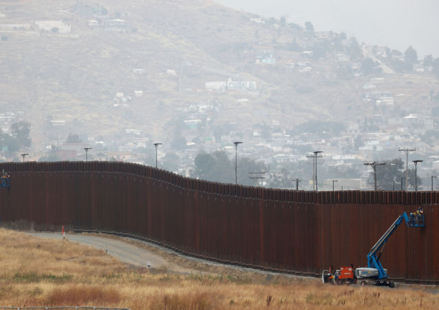 Workers weld sections of a newly replaced border wall with Tijuana, Mexico near the the Otay Mesa border crossing in San Diego, California May 31, 2019