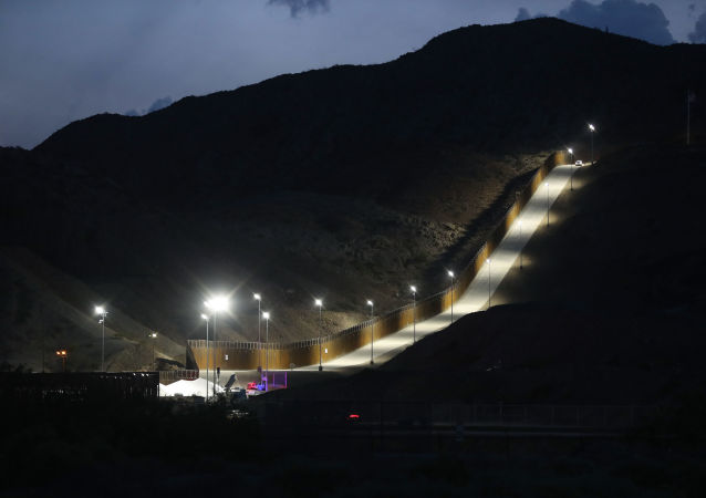 A section of border wall put in place by We Build The Wall Inc. stands at dusk on June 26, 2019 in Sunland Park, New Mexico