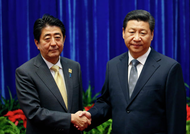 Japan's Prime Minister Shinzo Abe, left, and China's President Xi Jinping, right, shake hands during their meeting at the Great Hall of the People, on the sidelines of the Asia-Pacific Economic Cooperation (APEC) summit, in Beijing, Monday, Nov. 10, 2014. An uneasy handshake Monday between Xi and Abe marked the first meeting between the two men since either took power, and an awkward first gesture toward easing two years of high tensions.