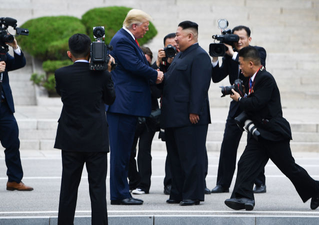 North Korea's leader Kim Jong Un shakes hands with US President Donald Trump north of the Military Demarcation Line that divides North and South Korea, in the Joint Security Area (JSA) of Panmunjom in the Demilitarized zone (DMZ) on June 30, 2019.