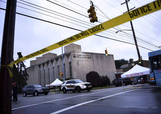 Police tape is viewed around the area on October 28, 2018 outside the Tree of Life Synagogue after a shooting there left 11 people dead in the Squirrel Hill neighborhood of Pittsburgh on October 27, 2018.