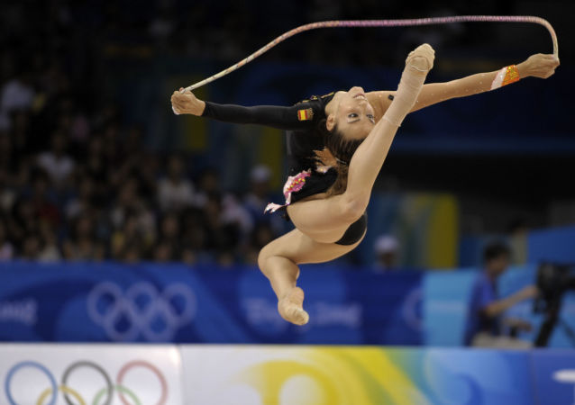 Spanish gymnast Almudena Cid performs with the rope during the rhythmic gymnastics individual at the Beijing 2008 Olympics in Beijing, Saturday, Aug. 23, 2008.  (AP Photo/Odd Andersen)