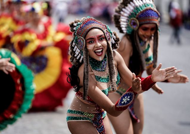 People parade during the Tropical Carnival on July, 7 2019 in Paris.