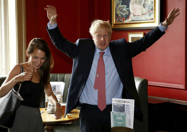 Conservative Party leadership candidate Boris Johnson gestures during a visit to Wetherspoons Metropolitan Bar in London, Wednesday July 10, 2019