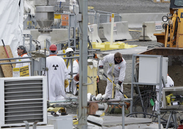 In this March 6, 2013 file photo, workers are shown at the 'C' Tank Farm at the Hanford Nuclear Reservation, near Richland, Wash. Conservation groups are alarmed by the Trump administration's proposal to rename some radioactive waste left from the production of nuclear weapons to make it cheaper and easier to achieve permanent disposal.