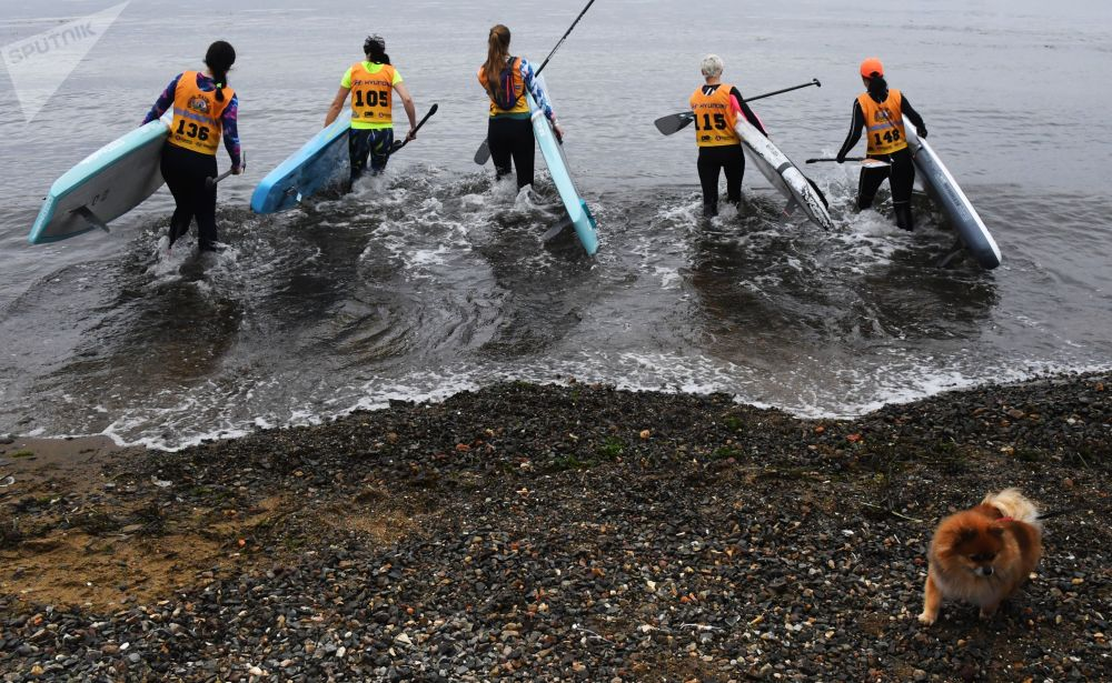Female participants during the fourth stage of SUP Surf Strong Waves Tour Cup in Russia's Vladivostok.