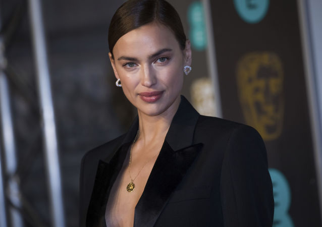 Irina Shayk poses for photographers upon arrival at the BAFTA awards in London, Sunday, Feb. 10, 2019