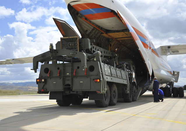 Military vehicles and equipment, parts of the S-400 air defence systems, are unloaded from a Russian transport aircraft, at Murted military airport in Ankara, Turkey, Friday, July 12, 2019