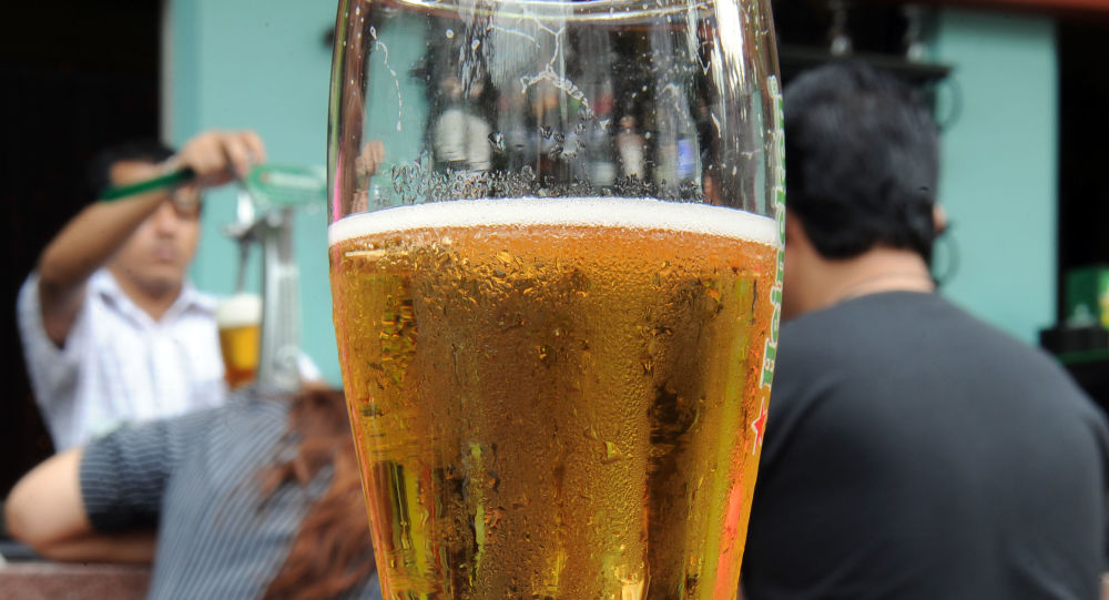 This photo taken on July 20, 2010 shows a bar-tender filling a glass with beer for a customer in Kuala Lumpur's vibrant Bukit Bintang nightlife district